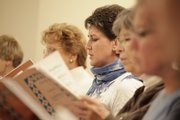 Soprano Deanna Stover, center, and the rest of the singers rehearse for a Spanish-language concert planned in Dec. 6 at Plymouth Congregational Church, 925 Vt.