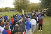 Jayhawk fans line the sidewalks near Allen Fieldhouse waiting for doors to open at the 2009 Late Night in the Phog.