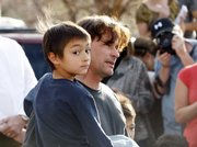 Six-year-old Falcon Heene is shown with his father, Richard, outside the family's home in Fort Collins, Colo., after Falcon was found hiding in a box in a space above the garage on Thursday. Falcon at first had been reported to be aboard a flying-saucer-shaped balloon fashioned by his father and then carried by high winds to the plains of eastern Colorado.