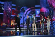 Svante Stockselius, Executive Supervisor of the Eurovision Song Contest, center, and Russian television Channel One director Konstantin Ernst, left, accompany Russian Prime Minister Vladimir Putin, second from left, during his visit May 9 to the Olympic Stadium in Moscow where the 2009 Eurovision Song Contest was held.