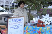Galina Conrad, rural Lawrence, sells sauces and chutney at the Lawrence Farmers' Market during the regular season, which runs from May to November. Many vendors from the market will sell their wares one more time this year at the Holiday Farmers' Market with goods not normally sold during regular season.