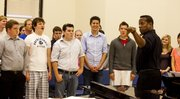 Paul Tucker, director of Kansas University's choral activities, leads a rehearsal with KU undergraduate and graduate students in Murphy Hall. They will perform in the 85th annual Holiday Vespers in December.