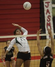 Free State's Chantay Caron (23) tries to drive a spike past Lawrence's Jasmyn Turner during the match on Thursday, Oct. 22, 2009, at LHS.