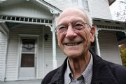 Harold Marcum, 80, has been selling real estate in Lawrence since 1972. He is pictured at a century-old house at 1300 Haskell Ave. that has been on the market for two years.