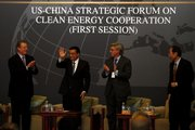 Chinese Vice Premier Li Keqiang, second from left, greets the audience Thursday attending the U.S.-China Strategic Forum on Clean Energy Cooperation in Beijing and is welcomed by former U.S. Vice President Al Gore, left; Chairman of the Board of the Brookings Institute John Thornton, second from right; and an unidentified man at right. Just 57 percent of Americans now think global warming is based on solid evidence.