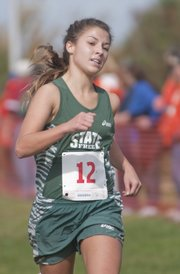 Free State's Hayley Francis runs to a fifth-place finish at regionals Saturday at Haskell Indian Nations University. Francis was among the city's individual qualifiers for state based on their regional results.