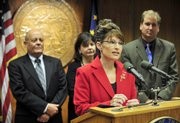 then-Alaska Gov. Sarah Palin addresses members of the media and legislators in Juneau, Alaska, in this Aug. 1, 2008, file photo after the state Senate approved a TransCanada proposal to build a natural gas pipeline.
