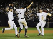 From left, New York's Derek Jeter, Alex Rodriguez and Mark Teixeira celebrate after winning Game 6 of the American League Championship Series. The Yankees beat the Angels, 5-2, on Sunday in New York.