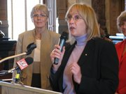 State Sen. Mary Pilcher-Cook, R-Shawnee, speaks Tuesday during news conference in Senate chamber on her proposed constitutional amendment that would make it unconstitutional to require a person to have health insurance under a proposed government plan. State Rep. Peggy Mast, R-Emporia, is in the background.