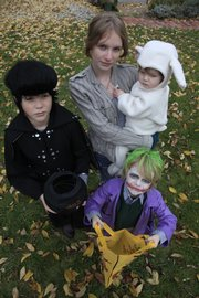 Sam Allen, 10, aka Elvis; Henry Allen, 6, as the Joker, and Ida Allen, 18 months, as a lamb, are ready to look for treats with mom Cary Allen, a nutritionist. To deal with the impending mound of candy, Allen says she took a tip from her dentist: Let the kids eat a lot for a short time and then take it away rather than stretch out the sugar-laden days by doling it out a piece at a time