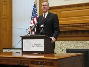 Gov. Mark Parkinson held a news conference Wednesday in the Capitol. Parkinson said he would balance the budget before lawmakers start the 2010 session in January. That means more cuts are likely.