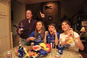 Gaumer family members, from left, K-State graduate, along with his daughter Alexa, 15, son Austin, 11, and wife/KU alumna Kathy get ready for Saturday's Sunflower Showdown. Doug plans to root for the Wildcats in a separate room from the rest of the family, who are Jayhawk fans.