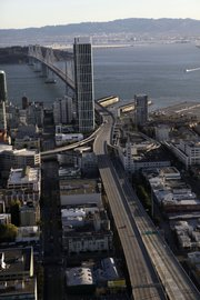 An empty Bay Bridge is shown in an aerial view Wednesday in San Francisco. The San Francisco-Oakland Bay Bridge has been closed indefinitely after a rod installed during last month's emergency repairs snapped, causing a traffic nightmare for the 280,000 motorists who cross the landmark span every day.
