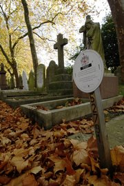 A sign indicates a burial plot for reuse Monday at the City of London Cemetery & Crematorium in east London. The British capital is quickly running out of places to bury people, with almost 8 million living and many millions more under the soil of a city that has been inhabited for 2,000 years.