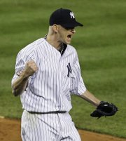 New York's A.J. Burnett reacts after striking out Philadelphia's Ryan Howard with two runners on base in the third inning. Burnett allowed one run in seven innings, and the Yankees defeated the Phillies, 3-1, on Thursday night in New York.