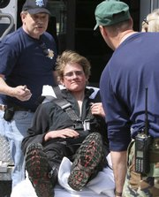 Scott Mason gets ready in this April 28 file photo to go to the hospital in Pinkham Notch, N.H. Mason was fined $25,000 by the state for the cost of his search and rescue.