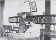 Professor C.G. Dunlap and Edith Charles, librarian in charge, work in the seminary room in the northeast corner of the Spooner Library's basement in this undated photo.
