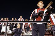 Zach Herries, Eudora, plays the cowbell during the football game on Friday, Oct. 23, 2009, at Eudora High School.  Kyle Snow, in blue in the background, learned the band's moves in order to push Zach, who has cerebral palsy, to allow him to perform with the band.