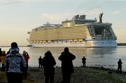 Royal Caribbean's Oasis of the Seas departs a ship yard Friday in Finland. The Oasis of the Seas is the largest passenger vessel ever built.