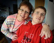 Jon Schoel, right, pictured Tuesday with his mother, Brenda Schoel, had wanted to play football at Nebraska. A virus when he was in the sixth grade at St. Mary's Grade School, Salina, cut that dream short and drastically changed his life. The Overland Park-based Kansas City Dream Factory helped him achieve the next best thing: going to a game  last Saturday in Lincoln, Neb., his first.