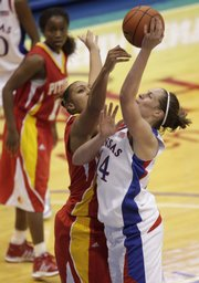 KU's Krysten Boogaard takes a shot with her left hand over a Pitt State defender during the game on Sunday, Nov. 1, 2009, at Allen Fieldhouse.