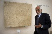 Omara Khan Massoudi, director of the Afghanistan National Museum in Kabul, speaks about one of the museum's ancient artifacts Oct. 24.