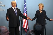 """U.S. Secretary of State Hillary Rodham Clinton and Israeli Prime Minister Benjamin Netanyahu react during a press conference Saturday in Jerusalem. Clinton said Israel is making """"unprecedented"""" concessions on West Bank settlement construction."""
