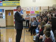 Gov. Mark Parkinson on Wednesday speaks with students at Whitson Elementary School in Topeka about H1N1 flu. Later, he told a reporter that he hoped to avoid a tax increase during the upcoming legislative session.