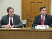 Gov. Mark Parkinson's budget director Duane Goossen (left), and Alan Conroy, director of the Kansas Legislative Research Department discuss new state revenue estimates Thursday in Capitol. The report shows continuing drop in tax receipts.