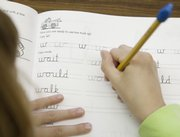 Deerfield third-grader Amanda Stinnett practices writing a W in cursive Thursday at school. Teachers across the country are battling to save the art of handwriting as electronic forms of communicating gain cultural dominance.