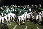 Camren Torneden (1) leads his team in a victory chant after defeating the Hawks 38-7  in the Class 6A regional play-off between Free State and Olathe East Friday, Nov. 6, 2009.