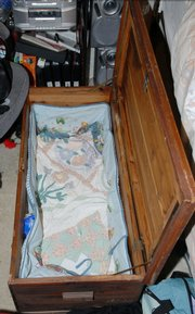 The 2-foot by 3-foot cedar box that law enforcement authorities found 7-month-old Shannon Dedrick in is shown in a photo provided Thursday by the Florida Department of Law Enforcement. The box was under the bed of her baby sitter in Chipley, Fla.