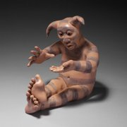 "A 1997 figure by artist Roxanne Swentzell, titled ""Kosha Appreciating Anything,"" is done in the Pueblo tradition."