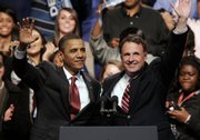 President Barack Obama and Virginia Democratic gubernatorial candidate Creigh Deeds wave to the crowd during a rally Oct. 27 in Norfolk, Va. Nervous Democrats are on the defense heading into 2010 and the midterm elections.