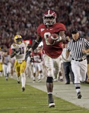 Alabama's Julio Jones (8) races to the end zone on a 73-yard touchdown reception during the second half. The Crimson Tide held off LSU, 24-15, on Saturday in Tuscaloosa, Ala.