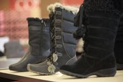 Suede boots, foreground, are especially in style at stores like Famous Footwear in south Lawrence.
