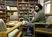 Professor Amardeep Singh sits in a common room at Lehigh University in Bethlehem, Pa., in this photo taken Thursday. Many Indians in America still find it difficult to keep their cultural heritage, as illustrated by a girl who pierced her nose and was suspended from school.