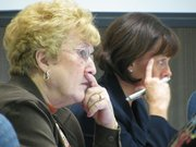 State Board of Education Chairwoman Janet Waugh, D-Kansas City, Kan. (left), and interim Education Commissioner Diane Debacker on Tuesday listen to school finance presentation from Deputy Education Commissioner Dale Dennis. Dennis said base state aid per pupil is decreasing because of budget problems.