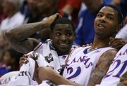 Kansas teammates Sherron Collins, left, and Marcus Morris chat on the bench during the second half Tuesday, Nov. 10, 2009 at Allen Fieldhouse.