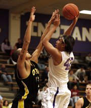 Haskell's D.J. Fish (42) shoots to pull the Fightin' Indians within a point, but HINU fell to Ottawa, 64-63, Wednesday at Coffin Complex.