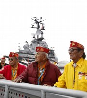 Navajo Code Talkers Joe Vandever, left, and Samuel Holiday look over the USS Intrepid Tuesday after a birthday celebration for the Marine Corps in New York.  The young Navajo Marines, using secret Navajo language-encrypted military terms, helped the U.S. prevail at Iwo Jima and other World War II Pacific battles.  The Code Talkers are in New York to march in the Veterans Day Parade and drum up support for a museum that will preserve their story.