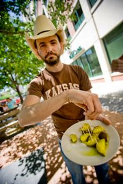 Matt Porubsky displays some of the restaurant's famous hot pickles.