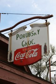 A weathered sign hangs above the front entrance of Porubsky's 508 N.E. Sardou Ave., Topeka.