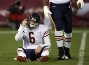 Chicago quarterback Jay Cutler sits on the ground after almost being sacked. Cutler threw five interceptions Thursday, includng one in the end zone on Chicago's final drive. The 49ers topped the Bears, 10-6, Thursday in San Francisco.