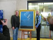 Lawrence artist Stan Herd and Kansas First Lady Stacy Parkinson on Friday stand beside a painting done by Herd during a news conference at the Kansas Museum of History. The work was one of nine awarded in a second-chance Kansas Lottery contest.
