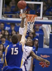 Kansas forward Thomas Robinson tries to block Hofstra forward's Halil Kanacevic floater during the first half, Friday, Nov. 13, 2009 at Allen Fieldhouse.