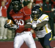 Cincinnati wide receiver Armon Binns, left, makes a touchdown catch against West Virginia's Brandon Hogan. Cincinnati won, 24-21, on Friday night in Cincinnati.