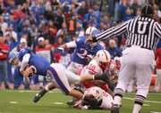Kansas quarterback Todd Reesing dives into the end zone for a touchdown against Nebraska during the first half, Saturday, Nov. 14, 2009 at Memorial Stadium.