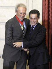 "U.S. actor and director Clint Eastwood, left, shakes hands Friday with French President Nicolas Sarkozy after being awarded the ""Commandeur de la Legion d'Honneur"" (Commander of the Legion of Honor) at the Elysee Palace, in Paris."