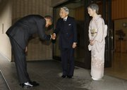 "U.S. President Barack Obama bows as he is greeted by Japanese Emperor Akihito and Empress Michiko after arriving today at the Imperial Palace in Tokyo. Obama said a robust China should be welcomed, not feared, as it sought to ""play a greater role on the world stage."" His trip is intended to showcase a United States seeking deeper and stronger Asian ties."